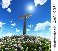 cross surrounded by flowers - stock photo
