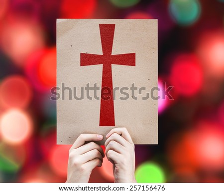 Cross Symbol card with colorful background with defocused lights - stock photo
