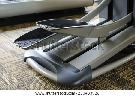 Cross trainer in a gym - stock photo