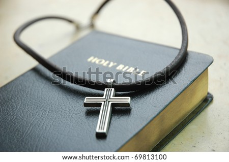 Cross with Bible - stock photo