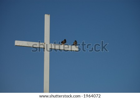 cross with 2 birds on top