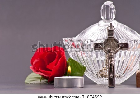 Cross with Holy Water and a Tea Candle - stock photo