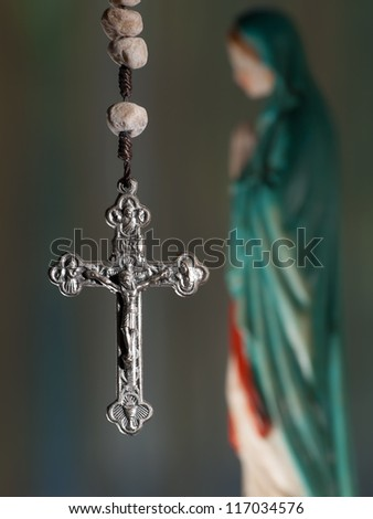 Cross with virgin Mary, closeup, for religious,spiritual themes - stock photo