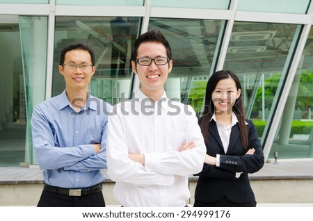 Crossed arms asian business executives