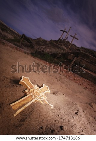 Crosses in the sand and in the distance - stock photo