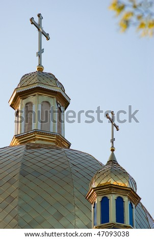 crosses on cupola of orthodox church on background of blue sky