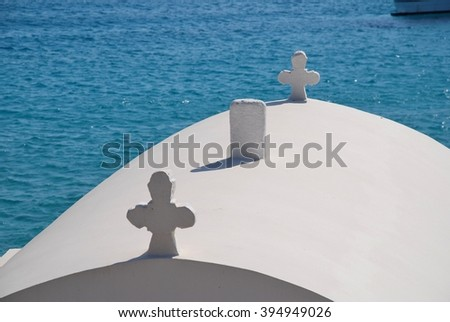 Crosses on the roof of a small chapel by Pondamos beach at Emborio on the Greek island of Halki.