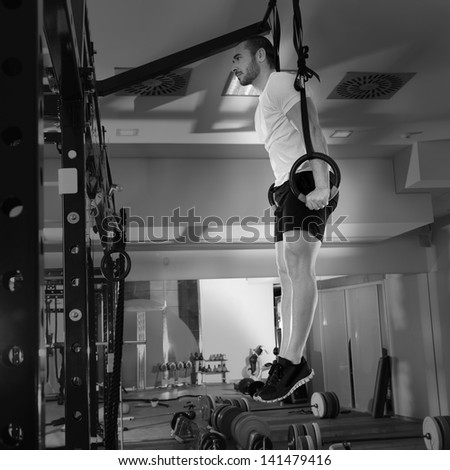 Crossfit fitness dip ring man dipping exercise workout at gym - stock photo
