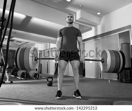 Crossfit fitness gym heavy weight lifting bar by strong man workout - stock photo
