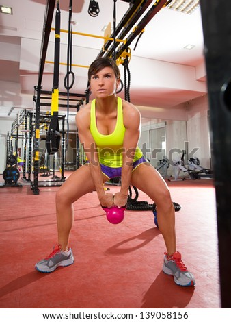 Crossfit fitness Kettlebells swing exercise woman workout at gym - stock photo