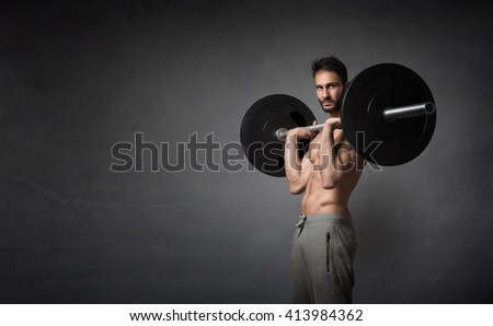 crossfitter portrait during exercise, dark background - stock photo