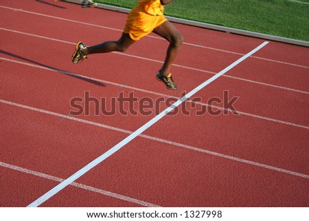 crossing finish line2 - stock photo