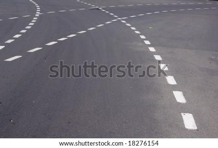 crossing lines of car ways in street asphalt - stock photo