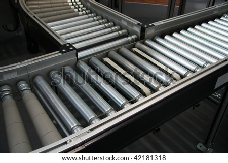 Crossing of the roller conveyor - stock photo