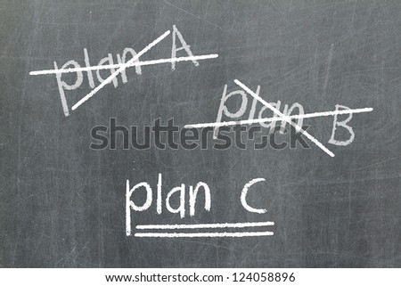 Crossing out Plan A and Plan B and writing Plan C, concept for change of plan - stock photo