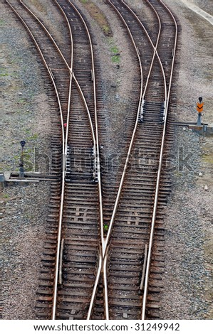 Crossing railroad track and signal lamps in a railway junction. - stock photo