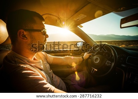 Crossing Southern California Desert by Car. Young Driver on the Journey. - stock photo