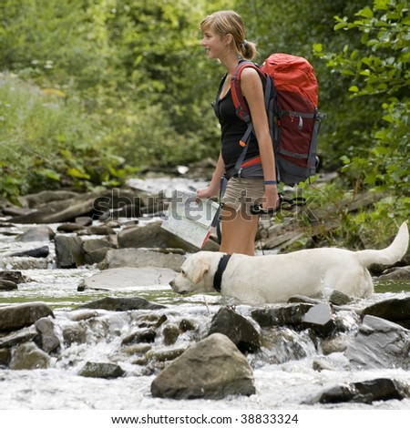Crossing through river - stock photo