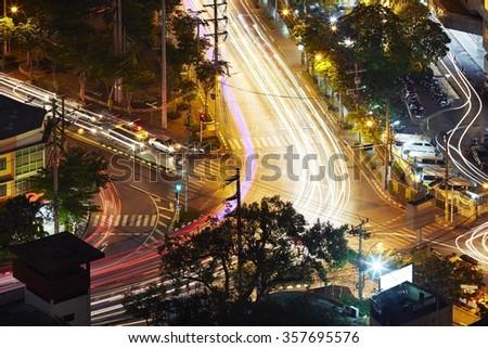 Crossroad at the night - Bangkok, Thailand - stock photo