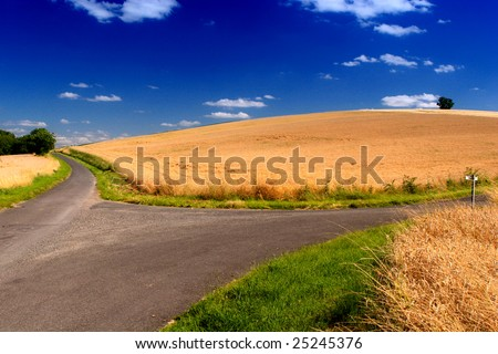 crossroads in fantastic landscape  in normandie, france - stock photo