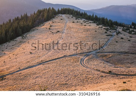 Crossroads in the mountains - stock photo