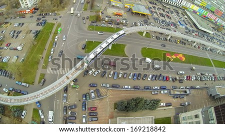 Crossroads of highways and railway with electric train near the telecentre, view from unmanned quadrocopter. - stock photo