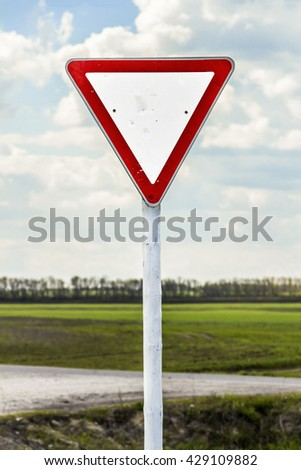Crossroads rural roads and main against the blue sky - stock photo