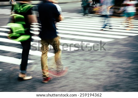 crosswalk and pedestrian at modern city zebra crossing street, blur abstract - stock photo