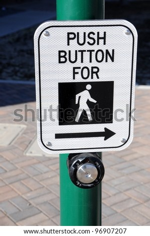 Crosswalk Pedestrian Signal Button and Sign - stock photo