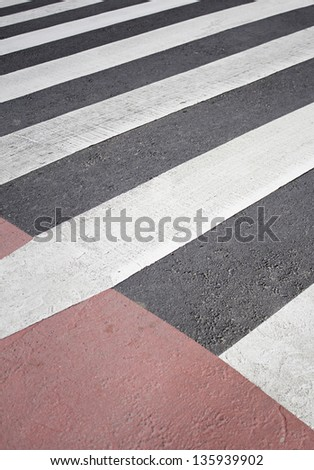 Crosswalk red and white roadside, road signs and regulations - stock photo