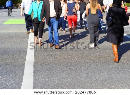 Crosswalk with pedestrians - stock photo
