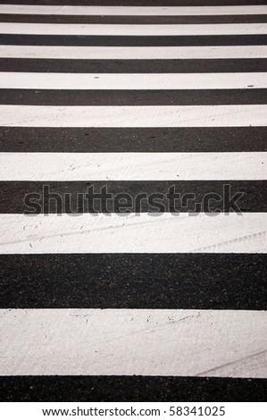 Crosswalk zebra in a city painted on asphalt - stock photo