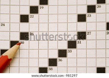 crossword page and a red pencil - stock photo