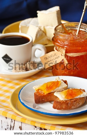 Crostini with camembert and marmalade for breakfast.