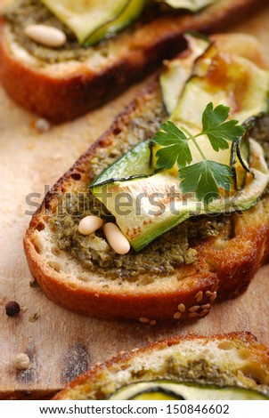 crostini with zucchini on the wooden table - stock photo