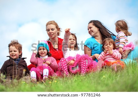 Croup of colorful kids having fun at spring - stock photo