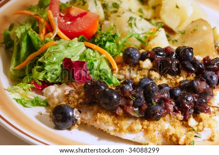 Crouton-crusted tilapia fillets with blueberry pepper sauce, salad and potatoes