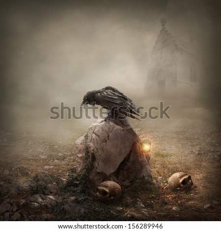 Crow sitting on a gravestone - stock photo