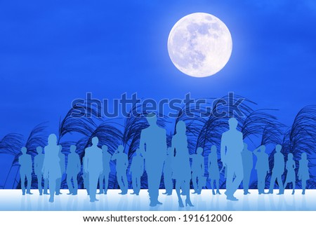 Crowd and the full moon - stock photo