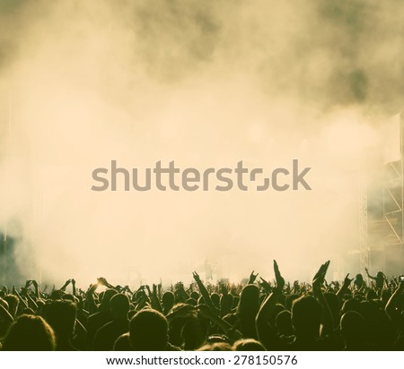 Crowd at concert - retro style photograph - stock photo