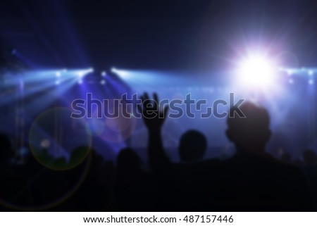 Crowd at concert,The word WORSHIP written in vintage metal letterpress type on a soft backlit background.christian music concert with raised hand,Vintage tone of christian  concert with raised hand