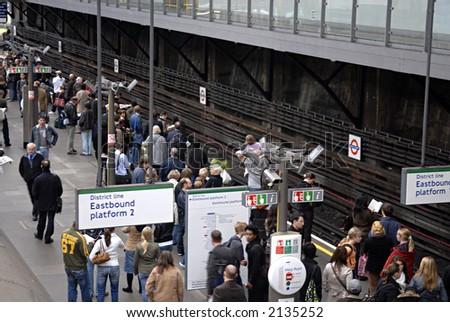 crowd at london tube station - stock photo
