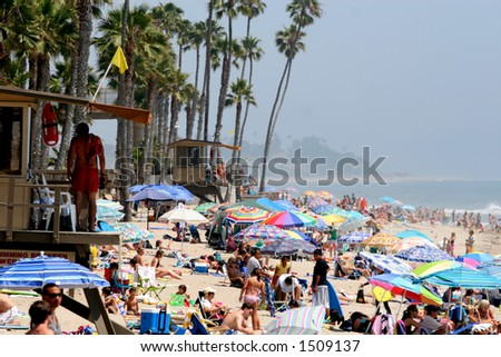 Crowd at the beach. - stock photo