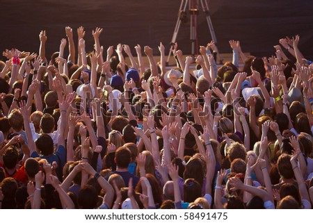 crowd celebrating wildly until early in the morning - stock photo