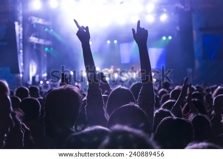 Crowd cheering at concert - stock photo