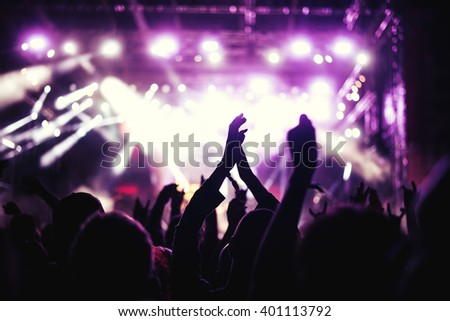Crowd enjoying a great party. Selective focus  - stock photo
