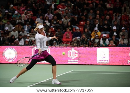 Crowd favourite Maria Sharapova at the Qatar Total Open 2008 semi-final, which the fifth seed and former Doha champion won. - stock photo