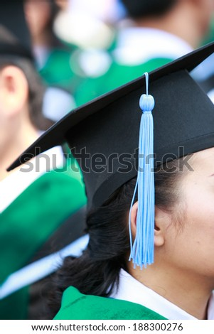 Crowd image of students at graduation ceremony from behind - stock photo