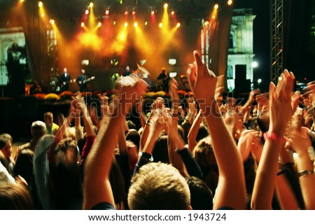 Crowd in blur at a rock concert. Crowd in long motion blur - stock photo