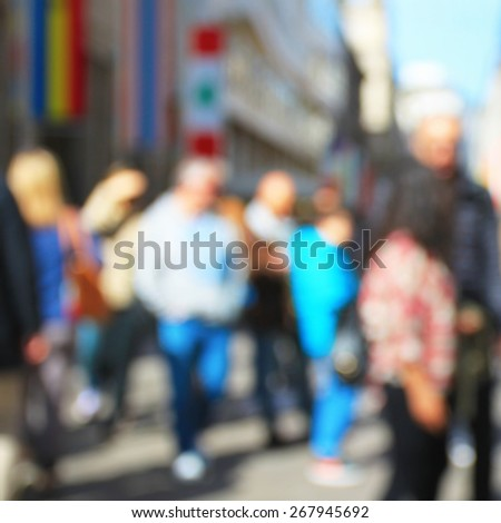 Crowd in spring city street - stock photo